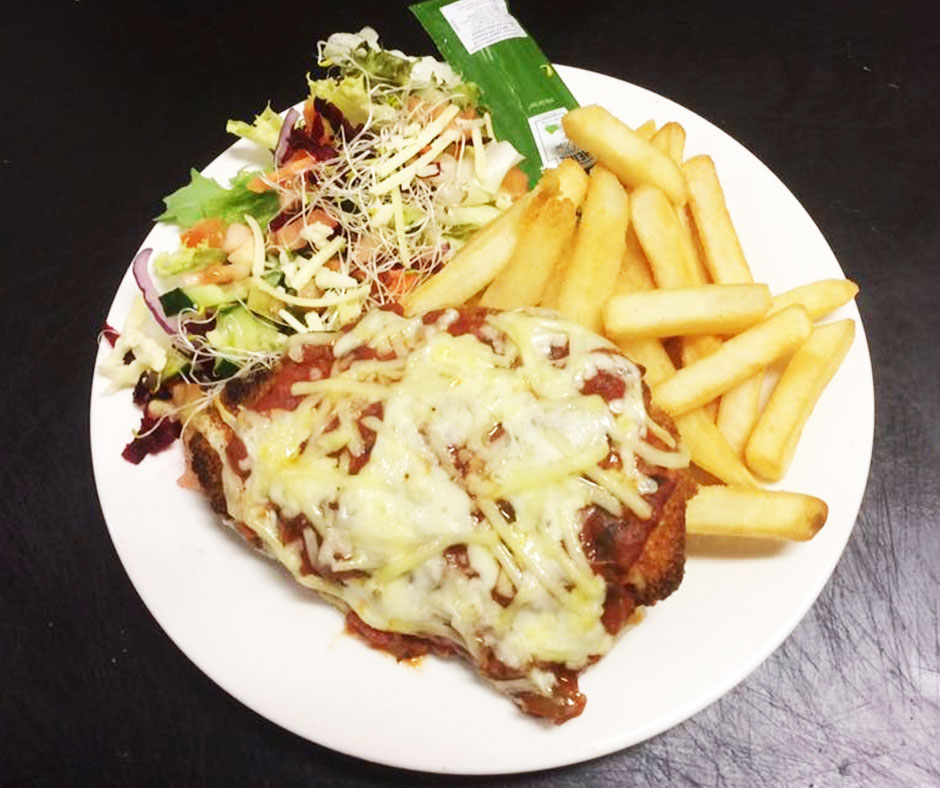 Chicken Breast Schnitzel Parmigiana Served With Chips Salad 23 95 Cafe Arabica